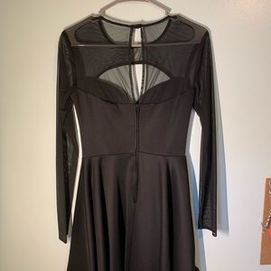 Black Dress. Mesh chest and sleeves. Padded.
